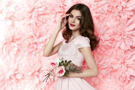 Beautiful sexy woman in dress many flowers makeup summer spring
