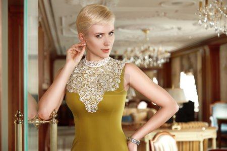 Beautiful sexy woman blonde hair evening make up dress business