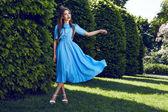 Beautiful sexy woman brunette walk in park sun shine dress