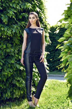 Beautiful sexy woman wearing dress walk in the park sun shine