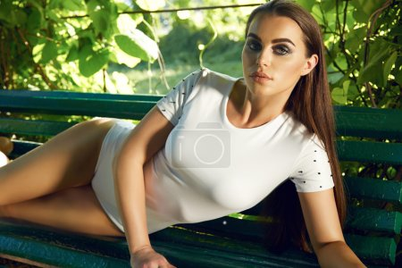 Beautiful sexy woman wearing dress walk park sun shine makeup