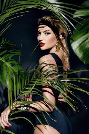 Beauty sexy woman makeup jungle palm sun tan shadows beach