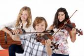 girls and a boy with musical instruments
