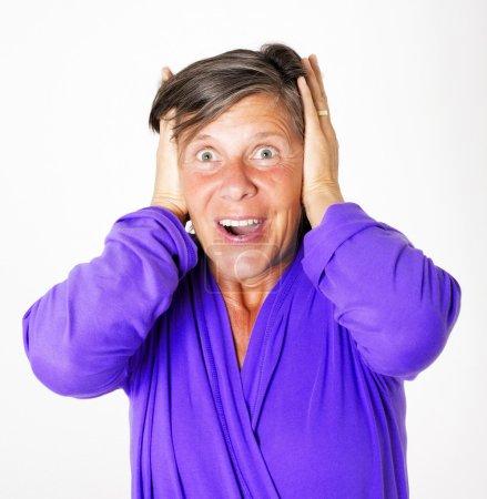 Photo pour Portrait of woman who is covering her ears from noise - image libre de droit