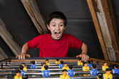 Boy at table football