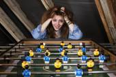 Girl at table football