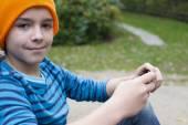 boy playing on phone