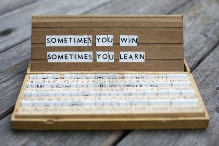 "Photo for The words ""sometimes you win sometimes you learn"" on an old school letter box - Royalty Free Image"