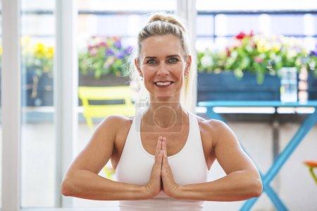 blond woman doing yoga