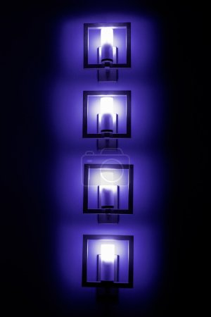 Set of bluewall lamps in the darkness