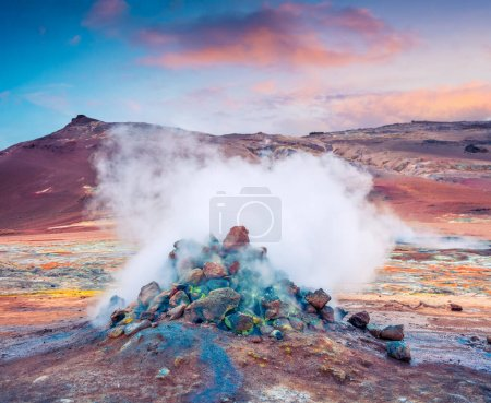 Photo for Steaming fumarole in geothermal valley Hverarond. Exotic summer sunrise of volcanic Icelandic landmark, Reykjahlid village location, north Iceland, Europe. Artistic style post processed photo. - Royalty Free Image