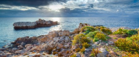 Photo for Dramatic spring sunset on the cape Milazzo, panorama of nature reserve Piscina di Venere, Sicily, Italy, Tyrrhenian sea, Europe. - Royalty Free Image