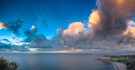 Photo for Evening cloudscape on the Milazzo cape, nature reserve Piscina di Venere, Sicily, Italy, Tyrrhenian sea, Europe. - Royalty Free Image