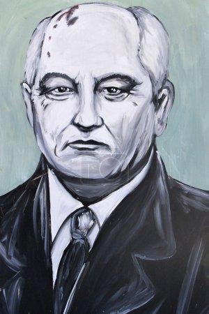 Foto de SETE, FRANCE  - SEPTEMBER 21, 2014: Graffiti portrait of Mikhail Gorbachev - a former Soviet statesman and last leader of the Soviet Union on the wall of Sete, south of France. - Imagen libre de derechos