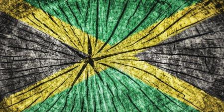 Photo pour Drapeau de la Jamaïque sur texture de bois fissuré - image libre de droit