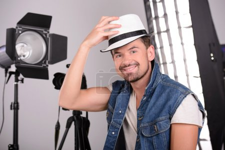 Photo for Attractive young man photographer at work in his studio - Royalty Free Image