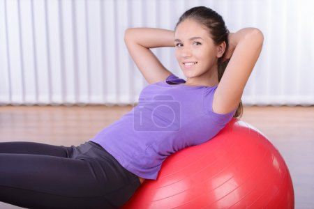 Woman on a fitness ball in a gym...