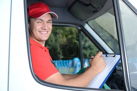 Photo for Postal service. Delivery of a package through a delivery service - Royalty Free Image