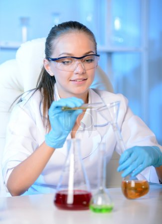 Photo for Chemist woman testing sample of liquid in laboratory - Royalty Free Image
