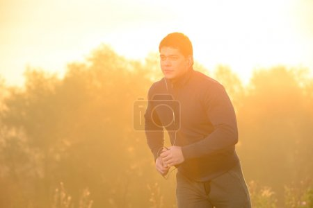 Photo for Young man running outdoors in the morning. - Royalty Free Image