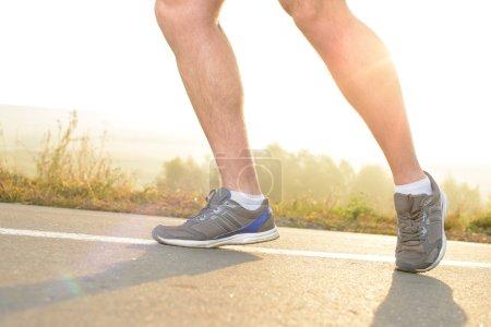Photo pour Healthy lifestyle fitness sports man running at park trail - image libre de droit