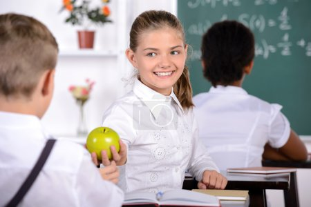 Photo for School child with teacher in classroom during lesson. concept of school - Royalty Free Image