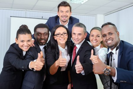 Photo for Group portrait of multiethnic business people smiling in office - Royalty Free Image