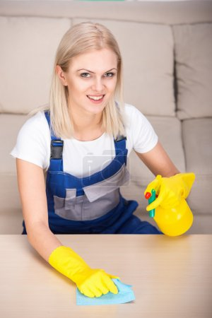 Photo for Portrait of woman is doing some cleaning work in the house. - Royalty Free Image