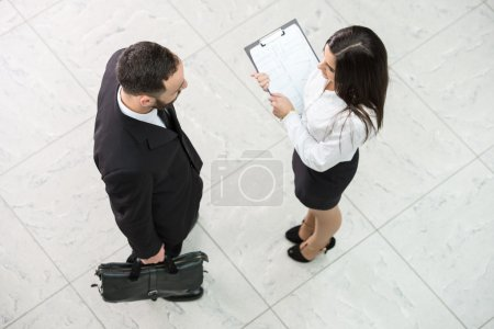 Photo for Top view of two business people at work. - Royalty Free Image