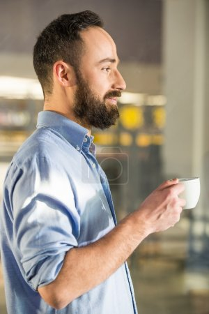 man with coffee