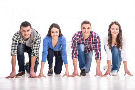 Photo for People on starting line. Group of young people are standing on starting line and are looking forward while isolated on white. - Royalty Free Image