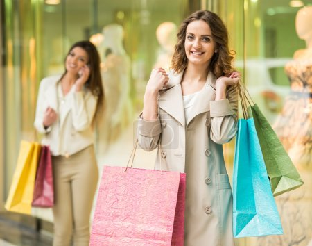 Photo for Two happy friends with shopping bag is shopping in mall. - Royalty Free Image