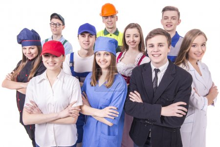 Foto de Joven grupo de trabajadores industriales. Aislado sobre fondo blanco. - Imagen libre de derechos