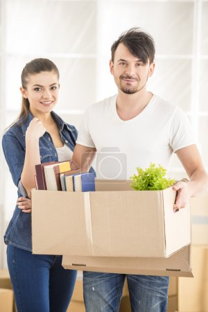 Photo for The young happy couple. Moving, purchase of new habitation. - Royalty Free Image