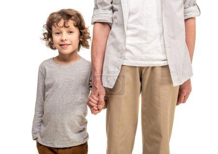 Photo pour Plan rapproché. Mains de fixation de père et de fils, un fond blanc d'isolement. - image libre de droit
