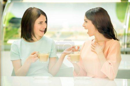 Girls sharing secrets