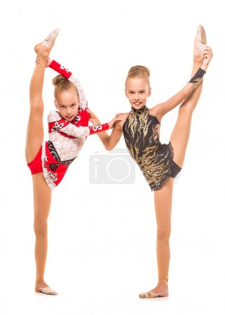Two sisters gymnasts doing vertical split, isolate...
