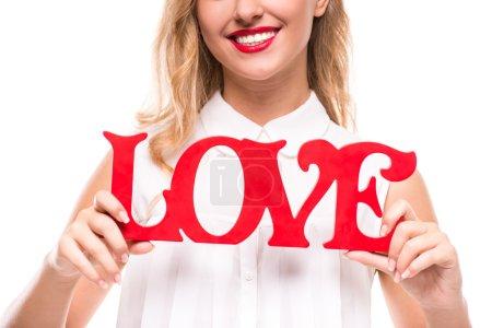 Photo pour Belle jeune femme tient un signe avec le mot : amour . - image libre de droit
