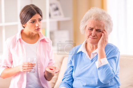 Photo for Care of senior woman at home sitting on the couch - Royalty Free Image