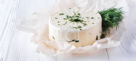 Photo for Pickled cheese with dill, spices and garlic on a white wooden background. Selective focus - Royalty Free Image