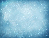 Light blue Christmas watercolor grunge background with falling snow and light sparkles