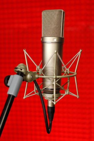 Professional Studio Microphone on red background...