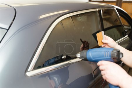 Tinting of glass in car