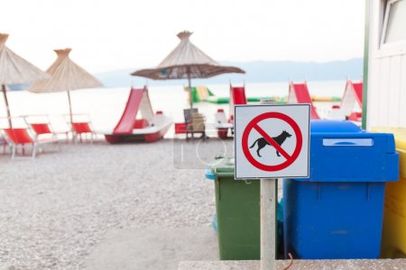 Photo for No entry.Signs announcing the ban on dogs on the beach. (Shallow DOF)Focus on brand blurred background. - Royalty Free Image