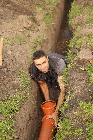 Photo pour Travaux sur les égouts domestiques - image libre de droit