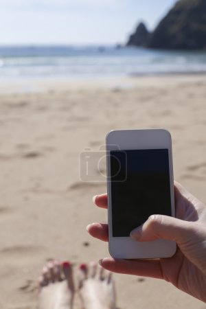 Using smartphone on a beach