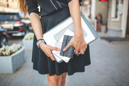 Businesswoman  in the city with documents