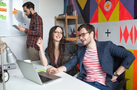 Yong hipster team working in modern office