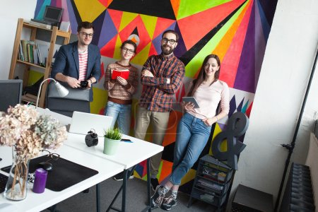 Creative team of four colleagues