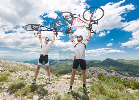 two cyclists on the top
